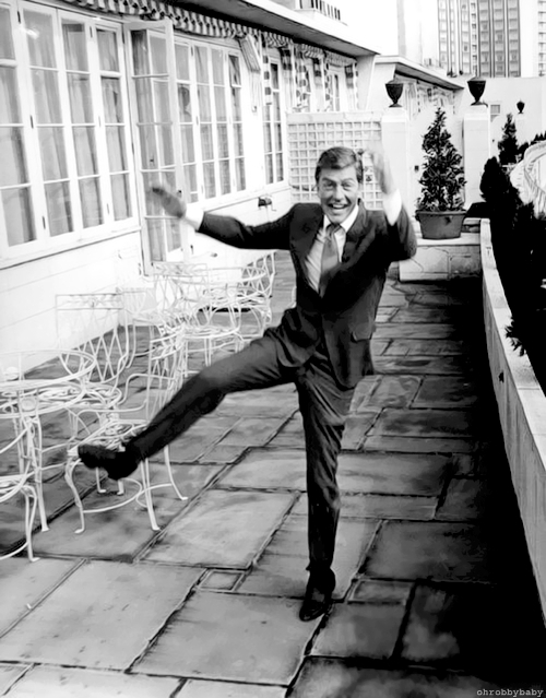 "31-5-67 Dick Van Dyke here for film – The popular American comedian, Dick Van Dyke, arrived in London yesterday. He is here to film and Ian Fleming story, ""Chitty Chitty Bang Bang"", to be produced by Cubby Broccoli at Pinewood. Photo Shows: Dick Van Dyke goes through a dance routine, on the terrace of his hotel in London yesterday."